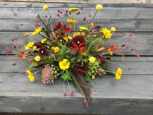 Rouwbloemen Haarlem geel en rood